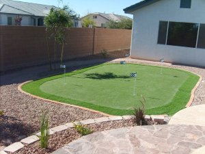 Adding artificial turf to this backyard.